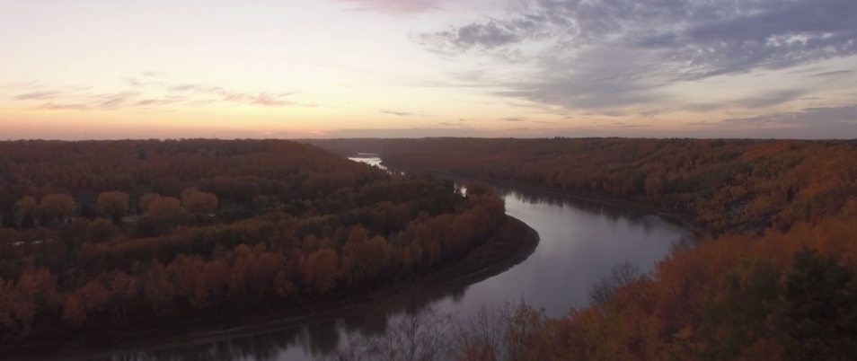aerial of river and trees in northern alberta